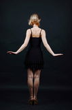 Young lady back view. Young lady from back holding hands like wings Stock Image
