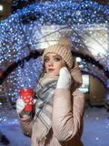 Young lady on the background of bokeh from Christmas garlands