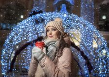 A young lady on the background of a bokeh from a large Christmas ball