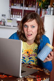 Young lady with bad internet connection at a cafe Royalty Free Stock Images