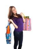 Young lady with bags. Attractive young lady with bags isolated on white background Royalty Free Stock Image