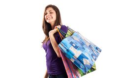 Young lady with bags. Attractive young lady with bags isolated on white background Stock Images