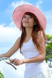 Young Lady with bicycle. Attractive Young Asian woman with bicycle outdoor Stock Photos