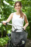 Young lady with bicycle Royalty Free Stock Images