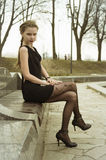 Young lady in black dress Stock Image