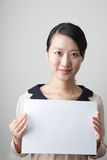 Young lady with a blank paper Stock Image