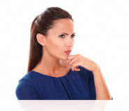 Young lady in blue blouse looking to her left Stock Photos