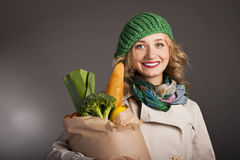 Young lady bought a lot of healthy food Stock Photo