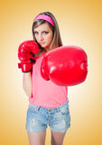 Young lady with boxing gloves on white Stock Images