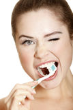 Young lady brushing her teeth Royalty Free Stock Photo