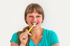 Young lady brushing teeth in the morning stock images