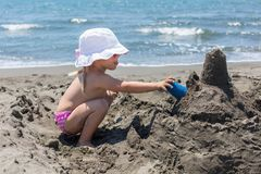 Young lady is building a sand castle Stock Photography