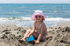Young lady is building a sand castle Stock Images