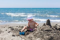 Young lady is building a sand castle Royalty Free Stock Photography