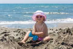 Young lady is building a sand castle Royalty Free Stock Photos