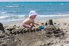 Young lady is building a sand castle Royalty Free Stock Images