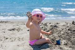 Young lady is building a sand castle Royalty Free Stock Photo