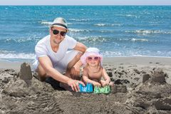 Young lady is building a sand castle Stock Photos