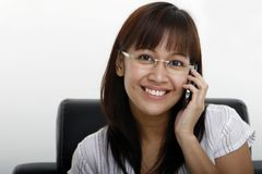 Young Lady Calling. A young lady using a mobile phone Royalty Free Stock Photography
