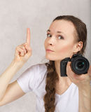 Young lady with a camera Royalty Free Stock Photography