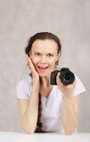 Young lady with a camera Royalty Free Stock Images