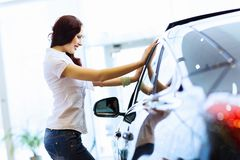 Young lady at car salon Royalty Free Stock Photography