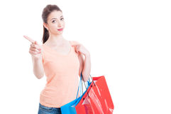 Young lady carrying shopping bags showing refusal or denial gest Royalty Free Stock Image