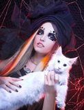 Young lady with cat. Gothic lady with artistic makeup posing witt white cat royalty free stock photos