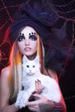 Young lady with cat. Gothic lady with artistic makeup posing witt white cat royalty free stock images