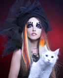 Young lady with cat. Gothic lady with artistic makeup posing witt white cat stock photos