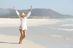 Young lady celebrating on the beach royalty free stock image