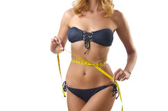 Young lady with centimetr - weight loss concept Stock Photo