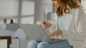 young lady checking balance on bank account using laptop card young lady checking balance on bank account using laptop card stock stock video footage