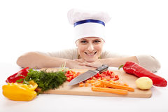Young lady chef with chopped vegetables Royalty Free Stock Photos