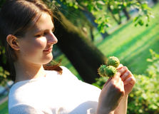 Young lady with chestnuts Royalty Free Stock Photos