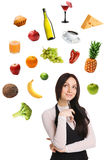 Young lady choosing from a variety of products stock photography