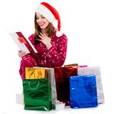 Young lady with christmas card and gifts Royalty Free Stock Image