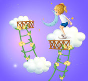 A young lady in the clouds Royalty Free Stock Images
