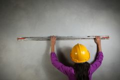 Young lady with concrete cement grouting action. Young lady with concrete cement grouting action on concrete wall represent the people and construction concept Royalty Free Stock Images