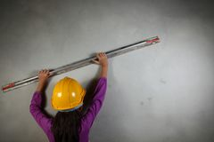 Young lady with concrete cement grouting action. Young lady with concrete cement grouting action on concrete wall represent the people and construction concept Stock Photography