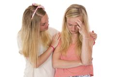 Sadness and Helping Friend. A young lady consoling a teen with a problem royalty free stock photos