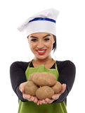 Young lady cook offering potatoes Royalty Free Stock Photo
