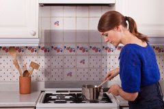 Young Lady Cooking Stock Photos