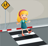 A young lady crossing the pedestrian lane Royalty Free Stock Photography