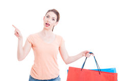 Young lady customer having great idea and holding shopping bags Royalty Free Stock Image