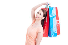 Young lady customer raising hand holding shopping bags Royalty Free Stock Images