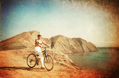 Young lady cycling in the mountains Stock Images