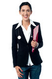 Young lady doctor holding clipboard Stock Photography
