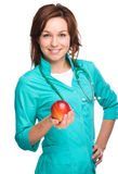 Young lady doctor is holding a red apple Stock Photos