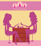 Young lady doing manicure in beauty salon Stock Image